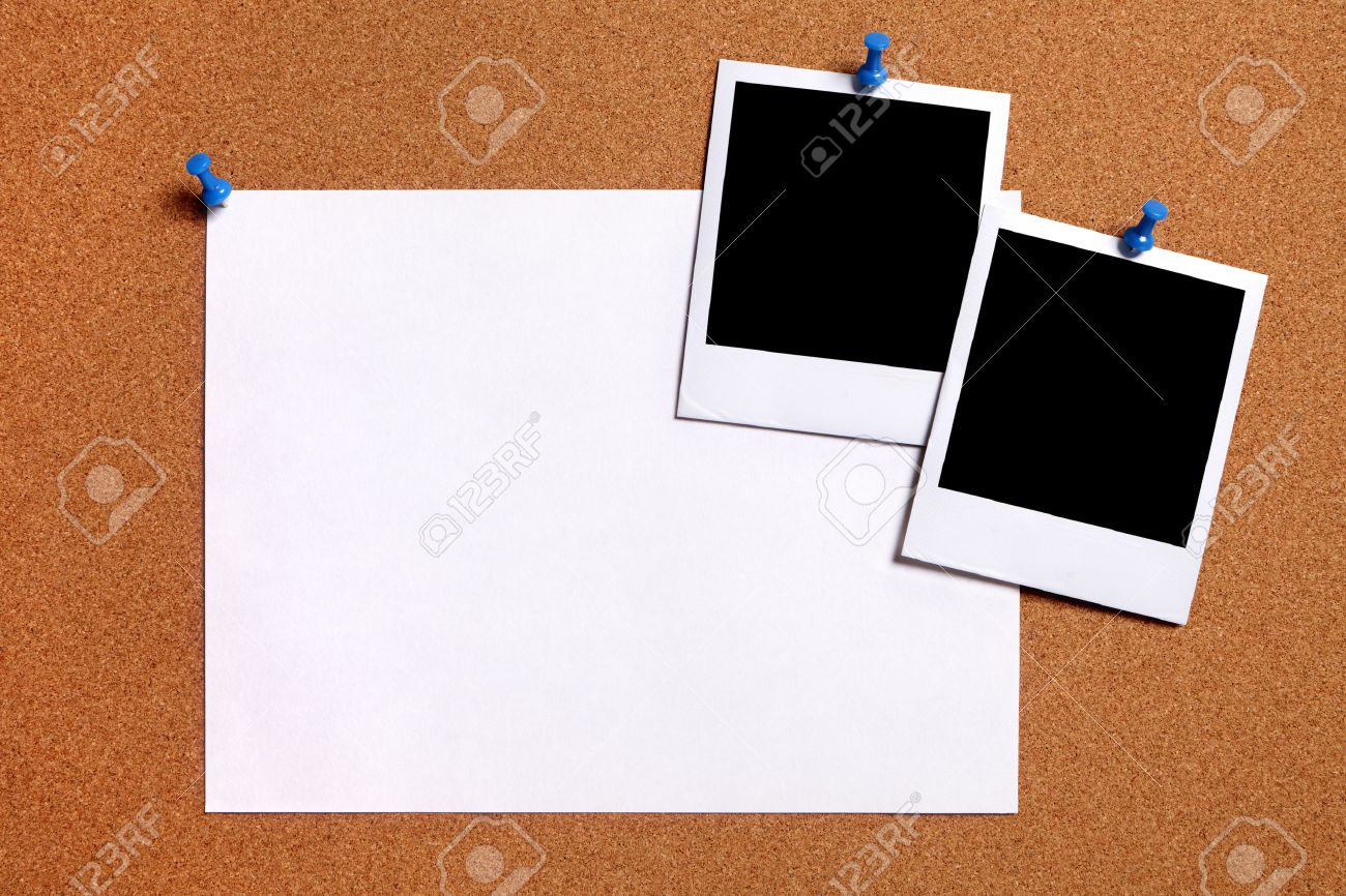 blank polaroid photo prints and plain paper poster pinned to stock