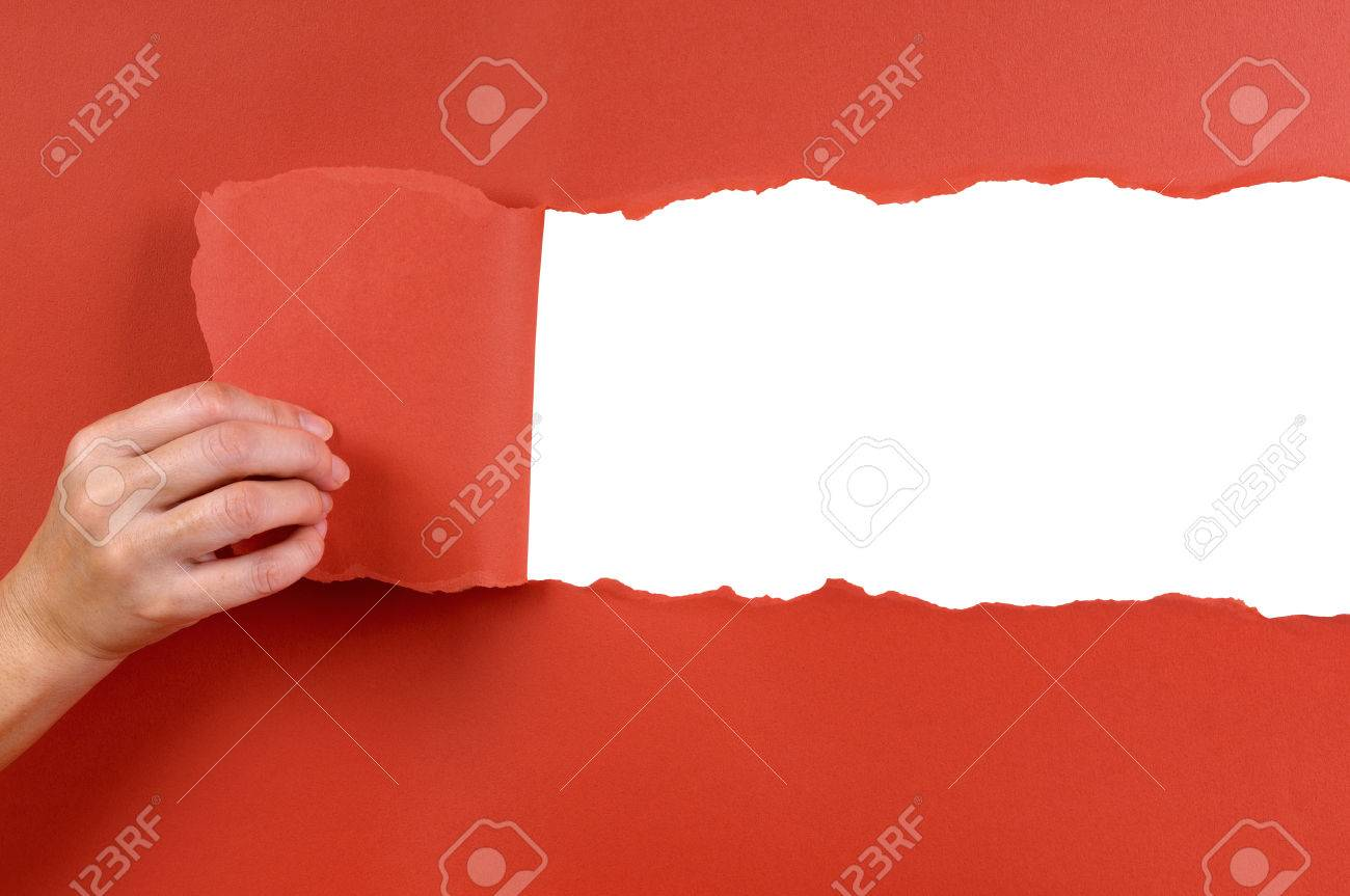 Hand tearing red paper background - 45716611