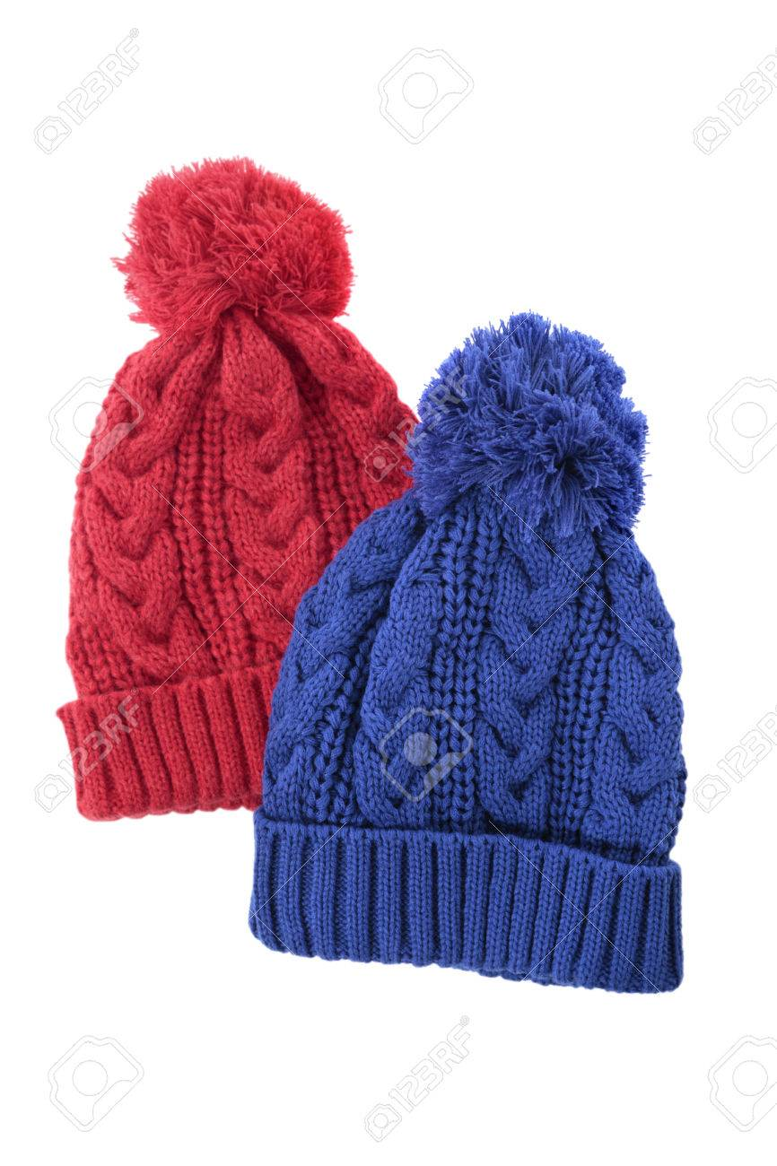 9170b4f7cab Red and blue cable knit bobble hats or ski hats isolated on a white  background.