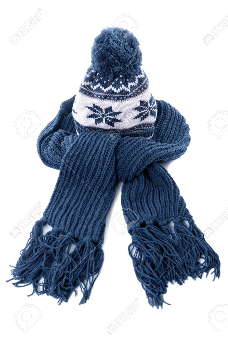 029bfb139db Blue knitted winter bobble hat and scarf isolated on a white background.  Stock Photo -