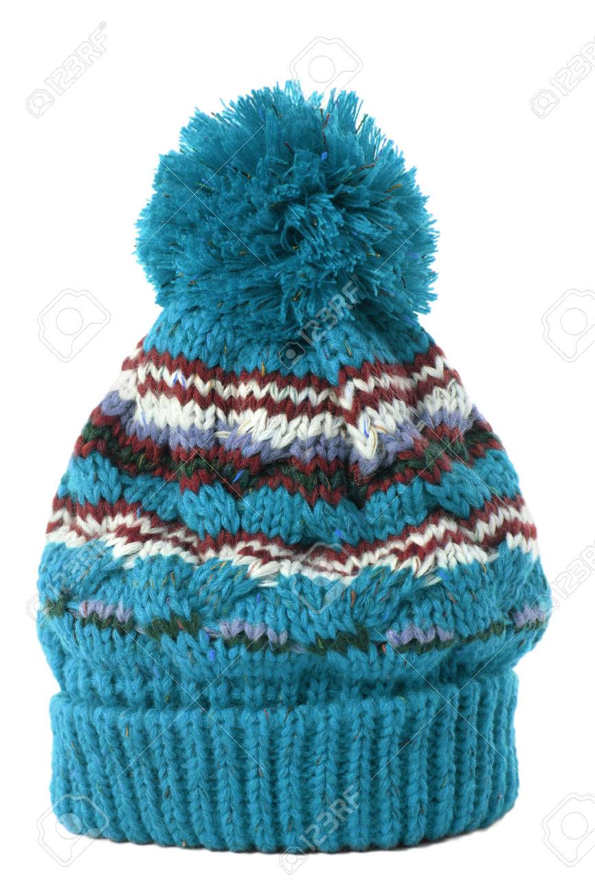 1772db5a298 Blue knitted bobble hat or ski hat isolated on a white background. Stock  Photo -