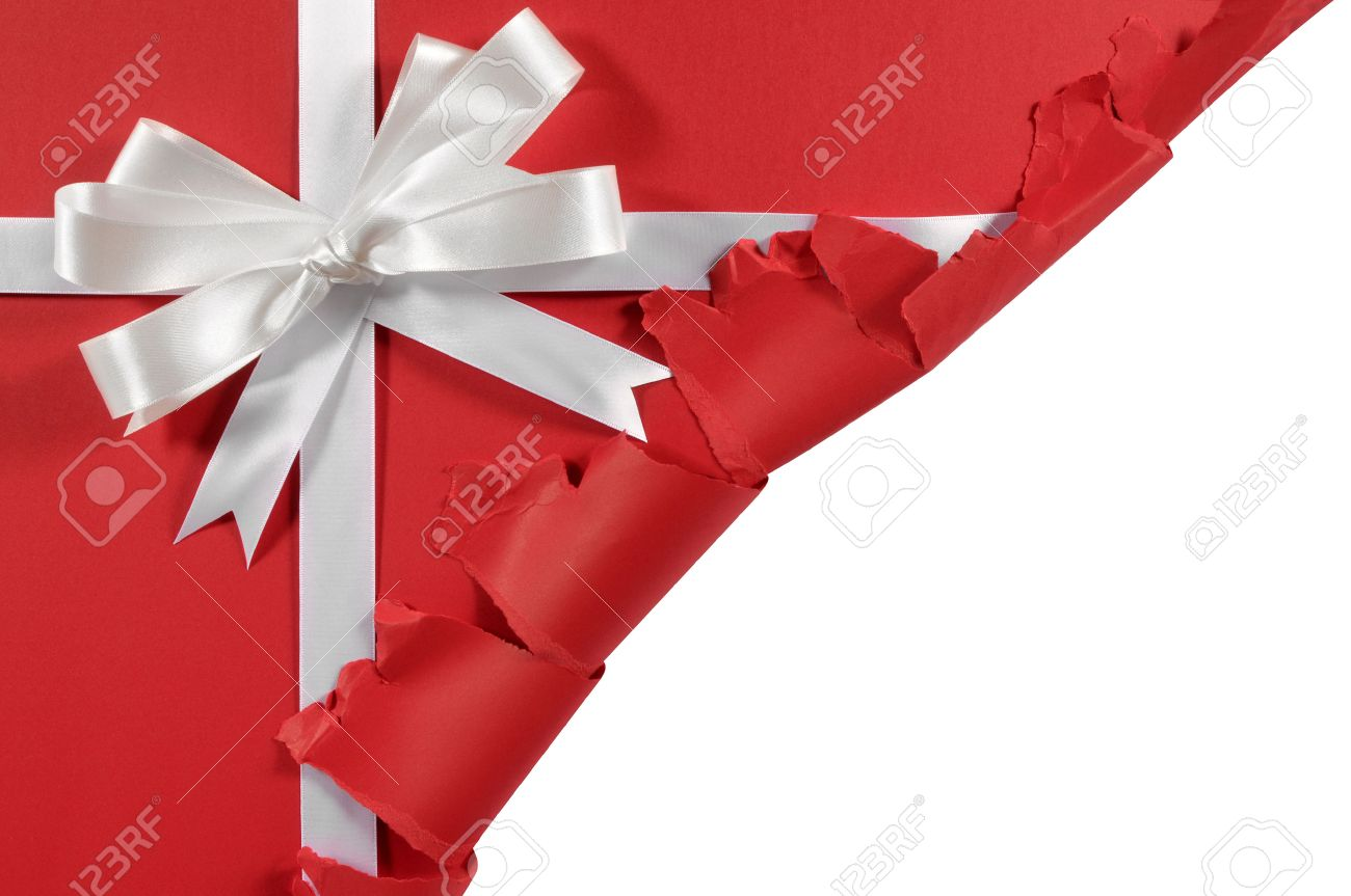Christmas or birthday white satin gift ribbon and bow on red paper background with torn open corner - 45895780