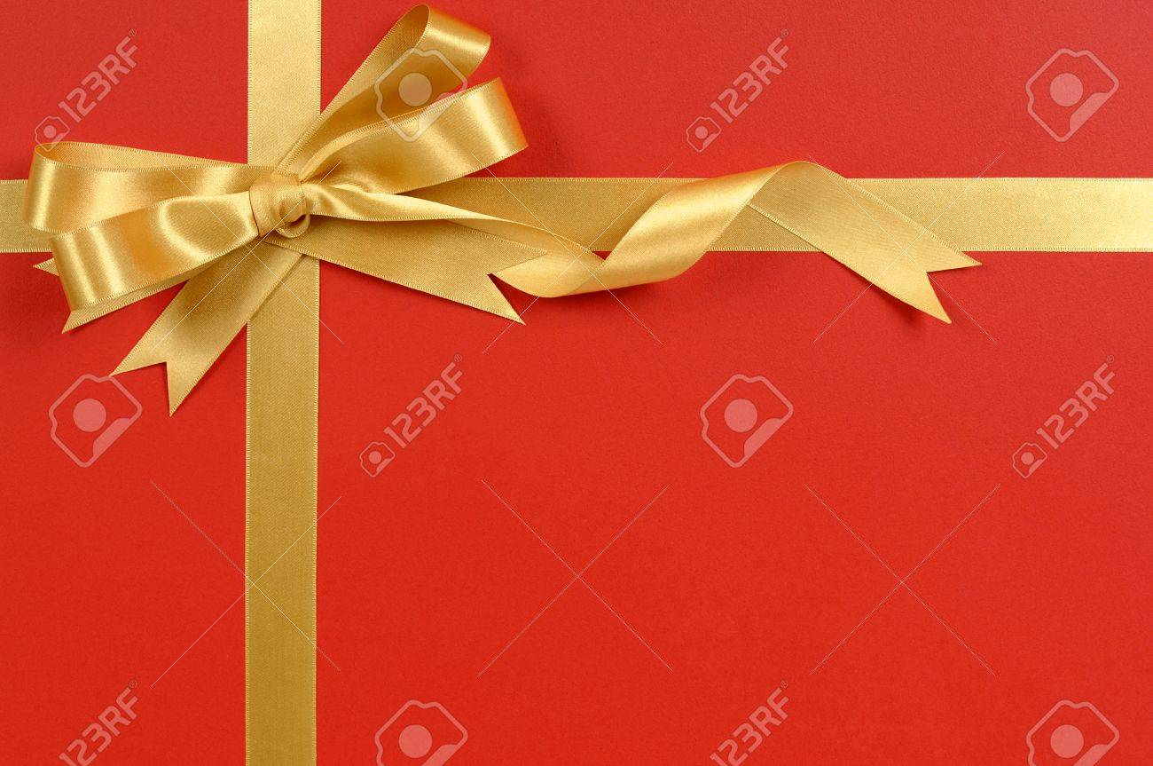 gold ribbon bow red gift wrap background copy space stock photo