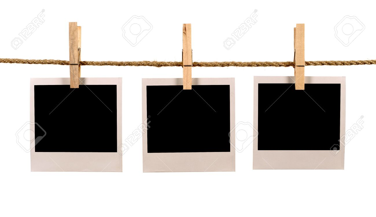 Several blank polaroid style instant photo print frames hanging on a rope or washing line, white background - 54150376