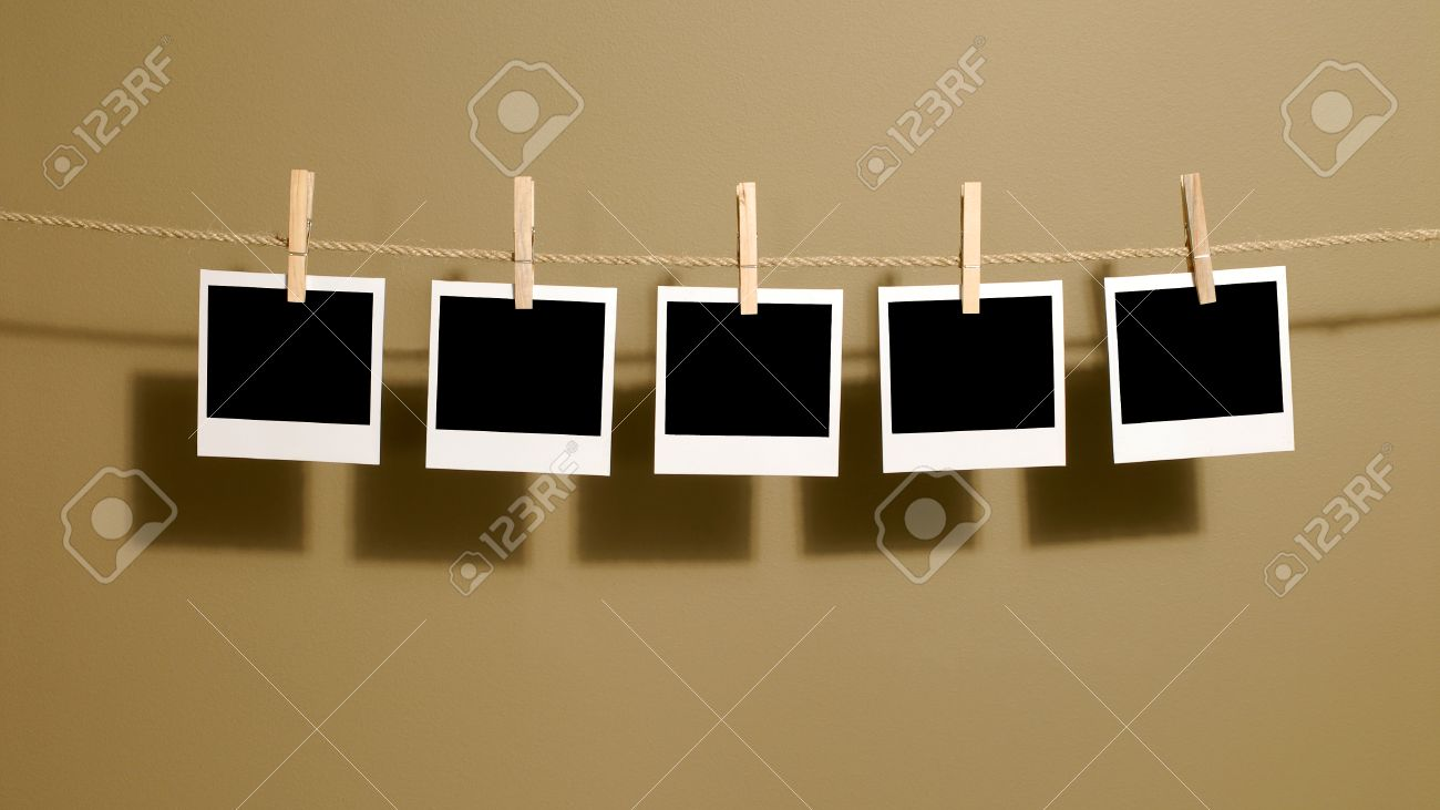 polaroid style instant photo prints hanging on a rope or washing