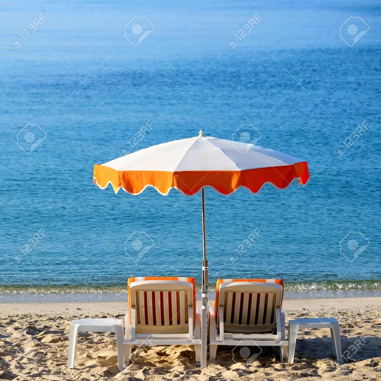 Mediterranean Beach Chairs Sun Umbrella Sunbathing Stock Photo   99423985