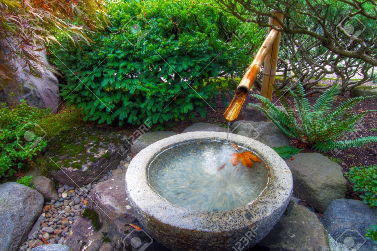 Captivating Stock Photo   Stone Basin Bamboo Water Fountain In Portland Japanese Garden