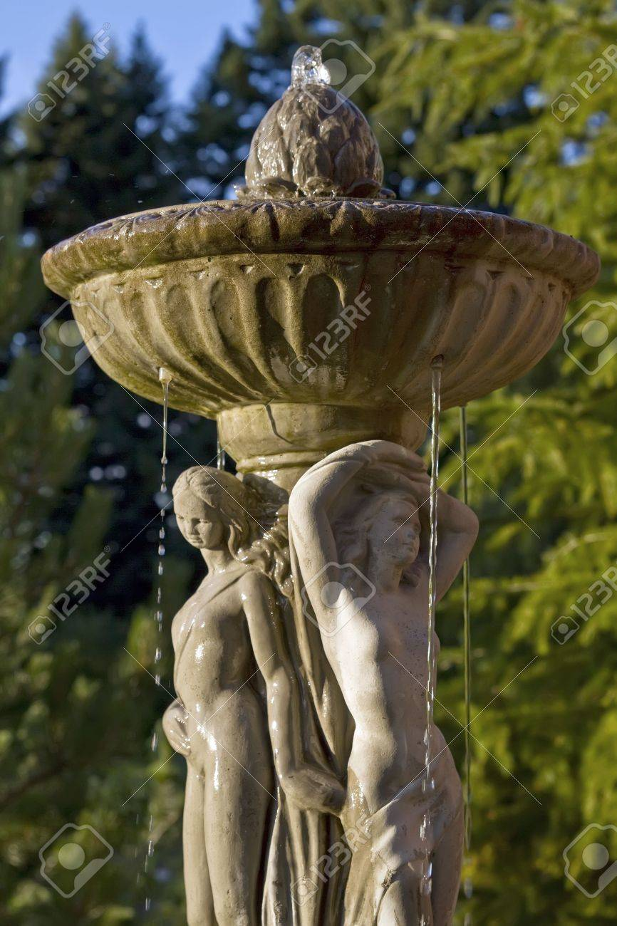 Water fountains with statues - Renaissance Sculpture Water Fountain In The Garden Stock Photo 7443512