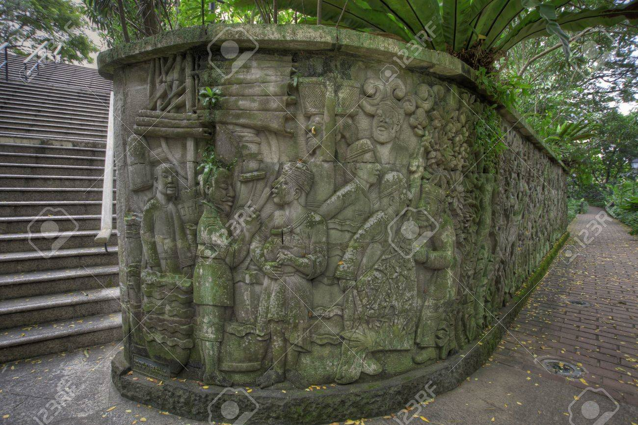 Balinese stone wall carvings in fort canning park singapore
