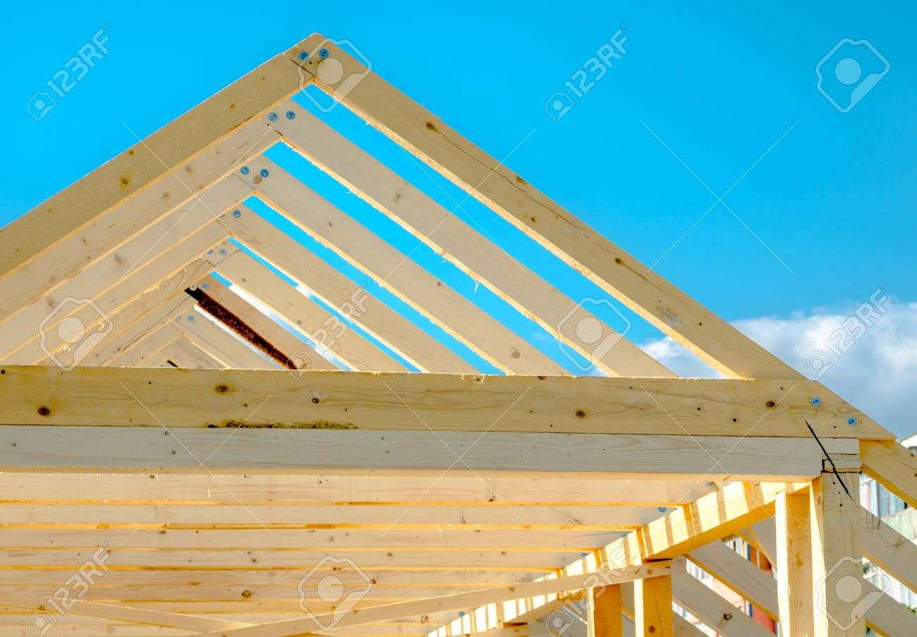 Rafters Of The Roof Frame Of A House Under Construction Stock Photo ...