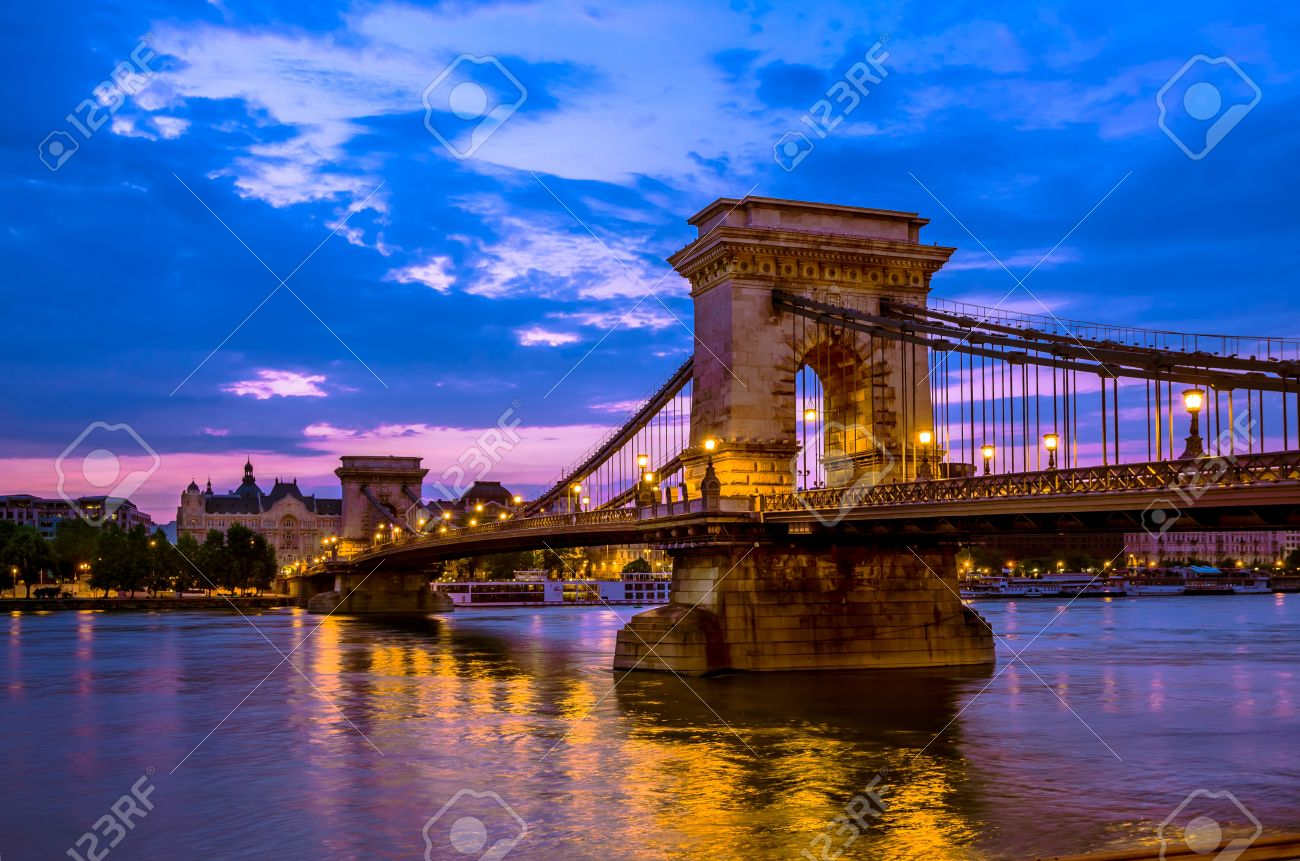 Szechenyi Chain Bridge is a suspension that spans the River Danube between Buda and Pest, in Budapest, the capital of Hungary  It was the first permanent bridge across the Danube in Budapest Stock Photo - 21965379