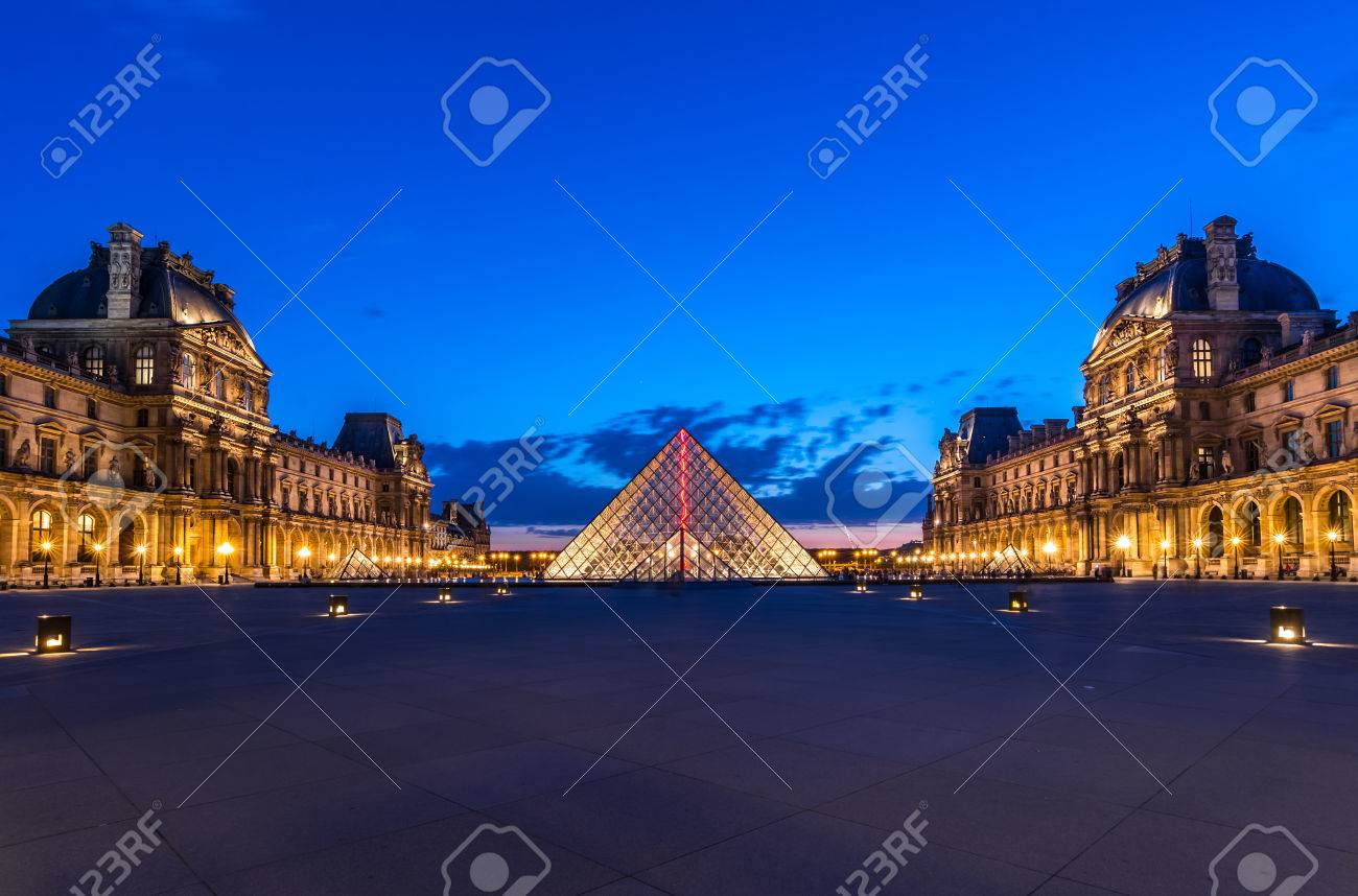 the louvre paris at twilight one of the major tourist attractions