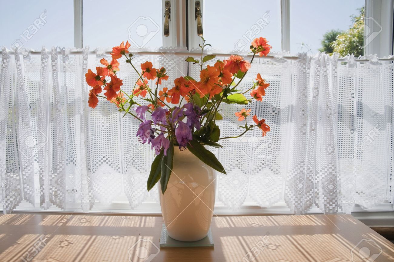 Cut flowers in a vase on a table inside a cottage stock photo cut flowers in a vase on a table inside a cottage stock photo 6235251 reviewsmspy