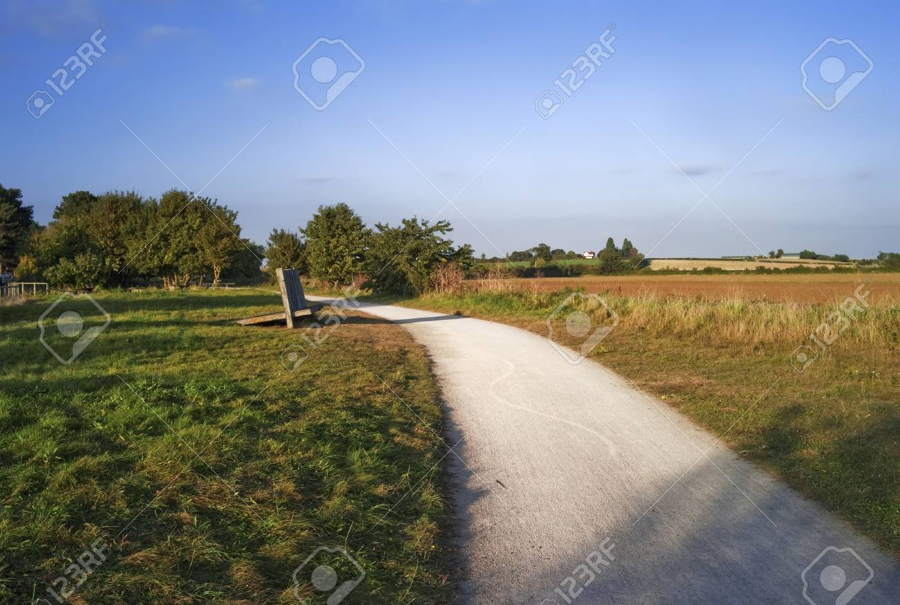 the greenway - disused railway line now a cycleway. stratford upon avon warwickshire. agricultural fields and farmlnad on either side. Stock Photo - 6397129