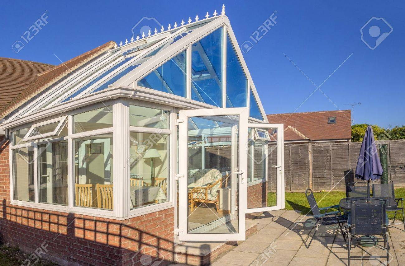 conservatory tables chairs plants room in house next to garden Stock Photo - 15152220