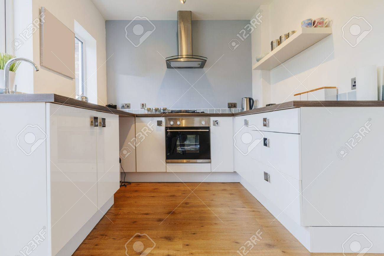 colour image kitchen in newly restored rebuilt house work surfaces - 19795840