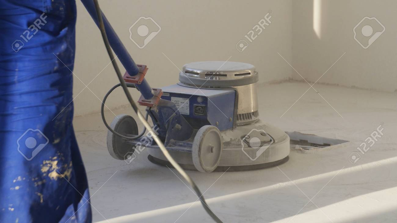 Man Polishing Marble Floor In Modern Office Building The People - How to polish marble floors by machine