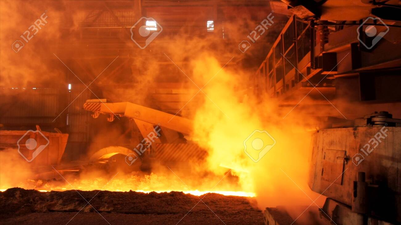 Hot steel being poured to the chute at the steel plant, heavy industry concept. Stock footage. Molten steel production in electric furnaces. - 120810191