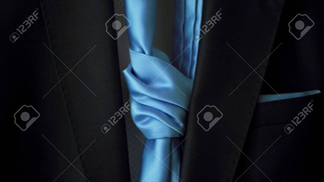 Male jacket with a blue tie, concept of business and official event. Close up of stylish blue men suit with a silk tie. - 140667117