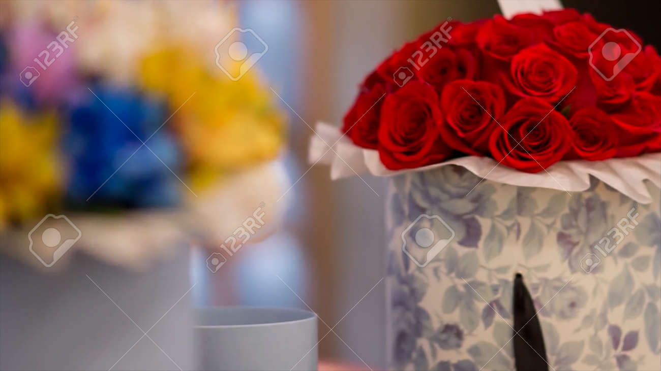 Creative decoration with bouquets of natural flowers in beautiful boxes. Video. Close up of colorful flowers as decor elements, concept of celebration. - 170440563