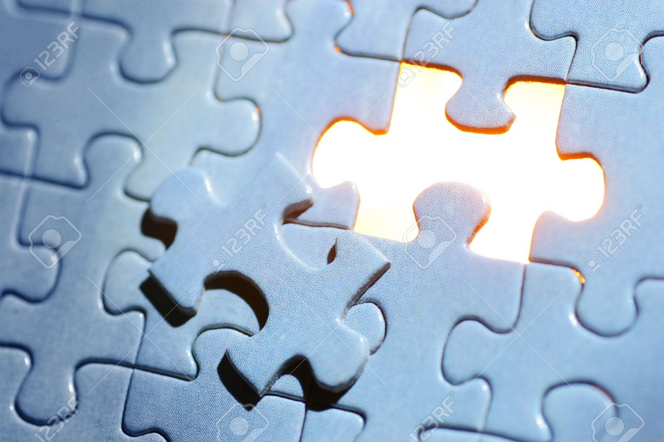 A Blue Jigsaw Puzzle Missing One Piece With Golden Light Showing Through Stock Photo