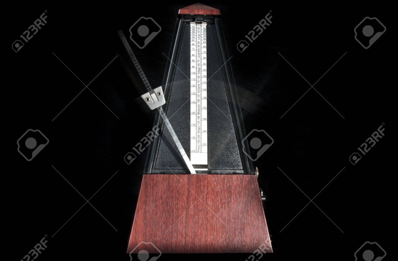 Wooden metronome working with black background Stock Photo - 17334726