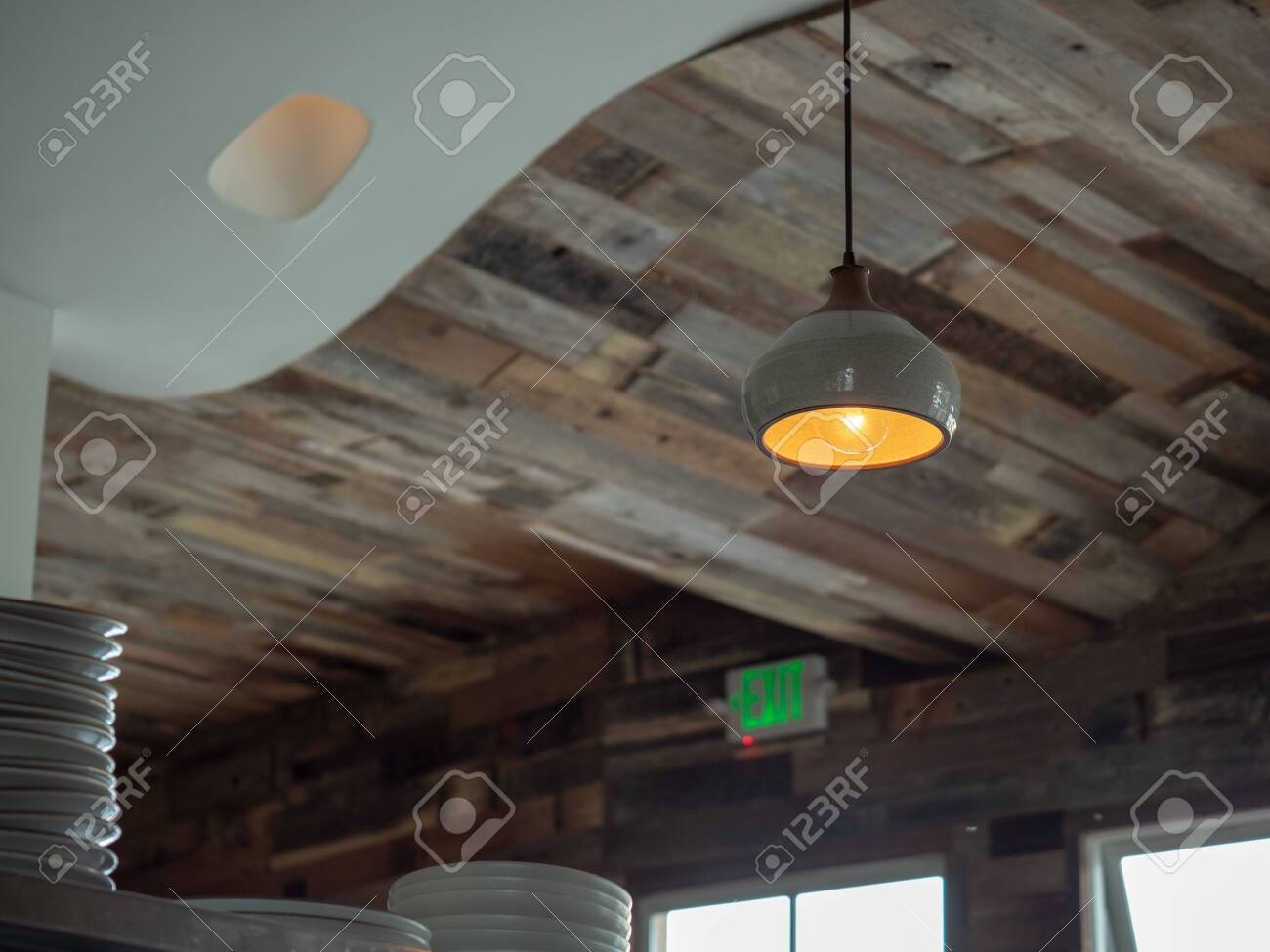 Wooden Roof Of Trendy Restaurant With Hanging Lights And Stack Stock Photo Picture And Royalty Free Image Image 113645935
