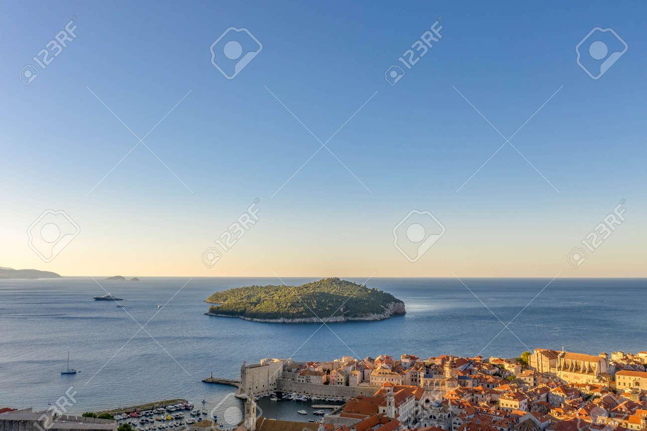 Aerial drone shot of Otok Lokrum in Dubrovnik in with port view in Croatia summer sunrise - 165813779