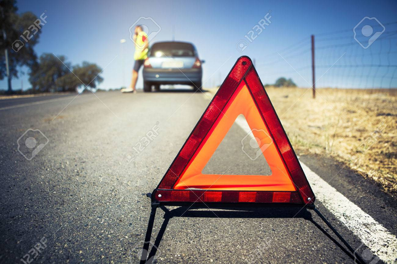Car colour affects road safety - Road Safety Emergency Triangle Man And Stopped Car In The Background