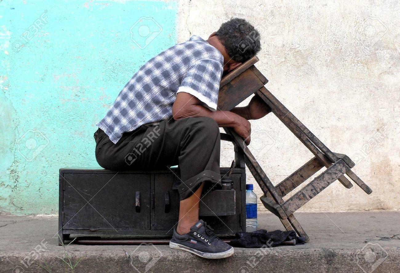 shoe shine man  at rest Stock Photo - 500288