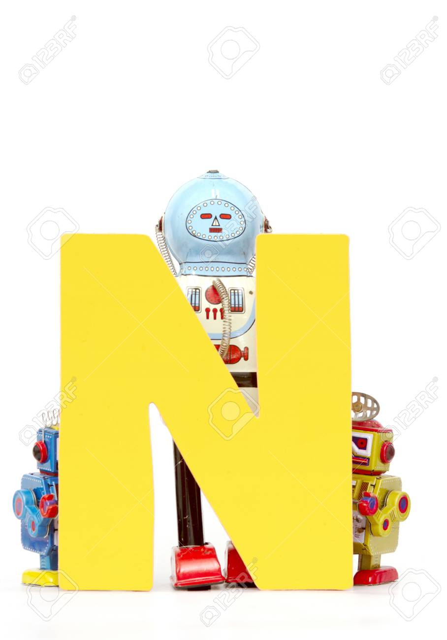 Capital Letter N Held By Vintage Robot Toys Stock Photo Picture And