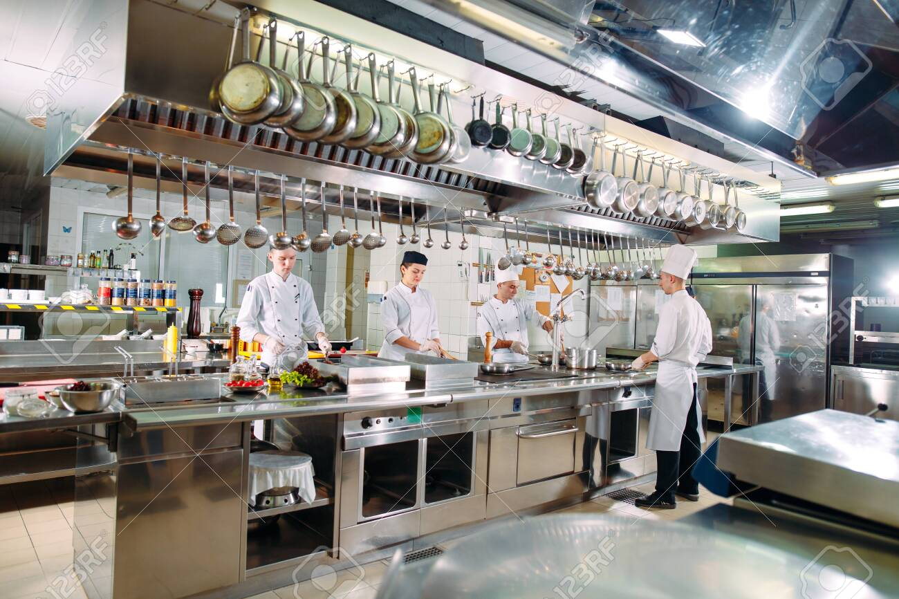 Modern Kitchen The Chefs Prepare Meals In The Restaurants Kitchen Stock Photo Picture And Royalty Free Image Image 128595544