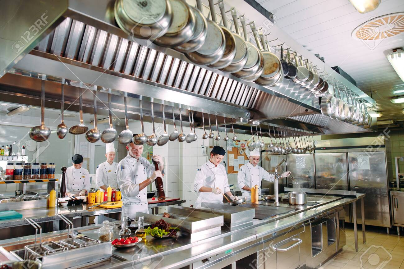 Modern Kitchen The Chefs Prepare Meals In The Restaurants Kitchen Stock Photo Picture And Royalty Free Image Image 128595368
