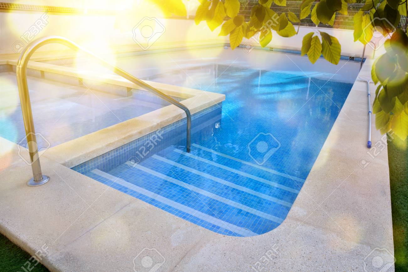 Swimming Pool In Garden With Stairs Of Work And Blue Mosaic Tiles ...