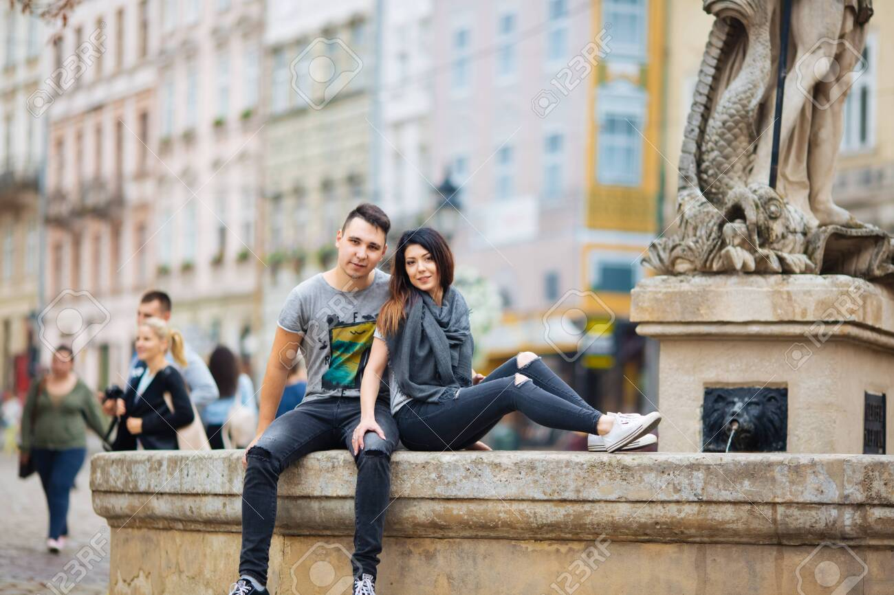 couple posing on the streets of a European city in summer weather. - 148039592
