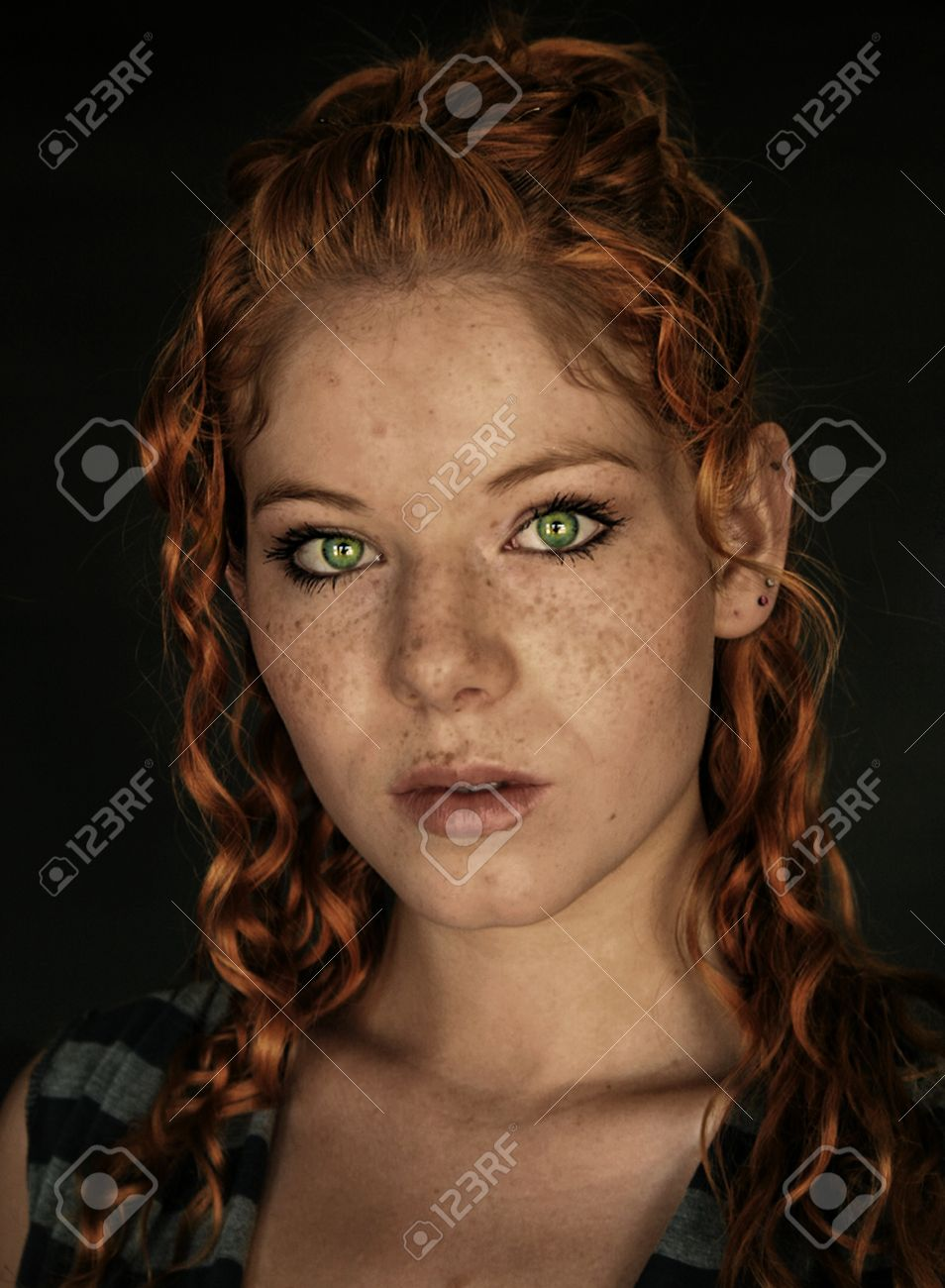 A freckled young woman with copper red hair, and vibrant green eyes. - 19293137