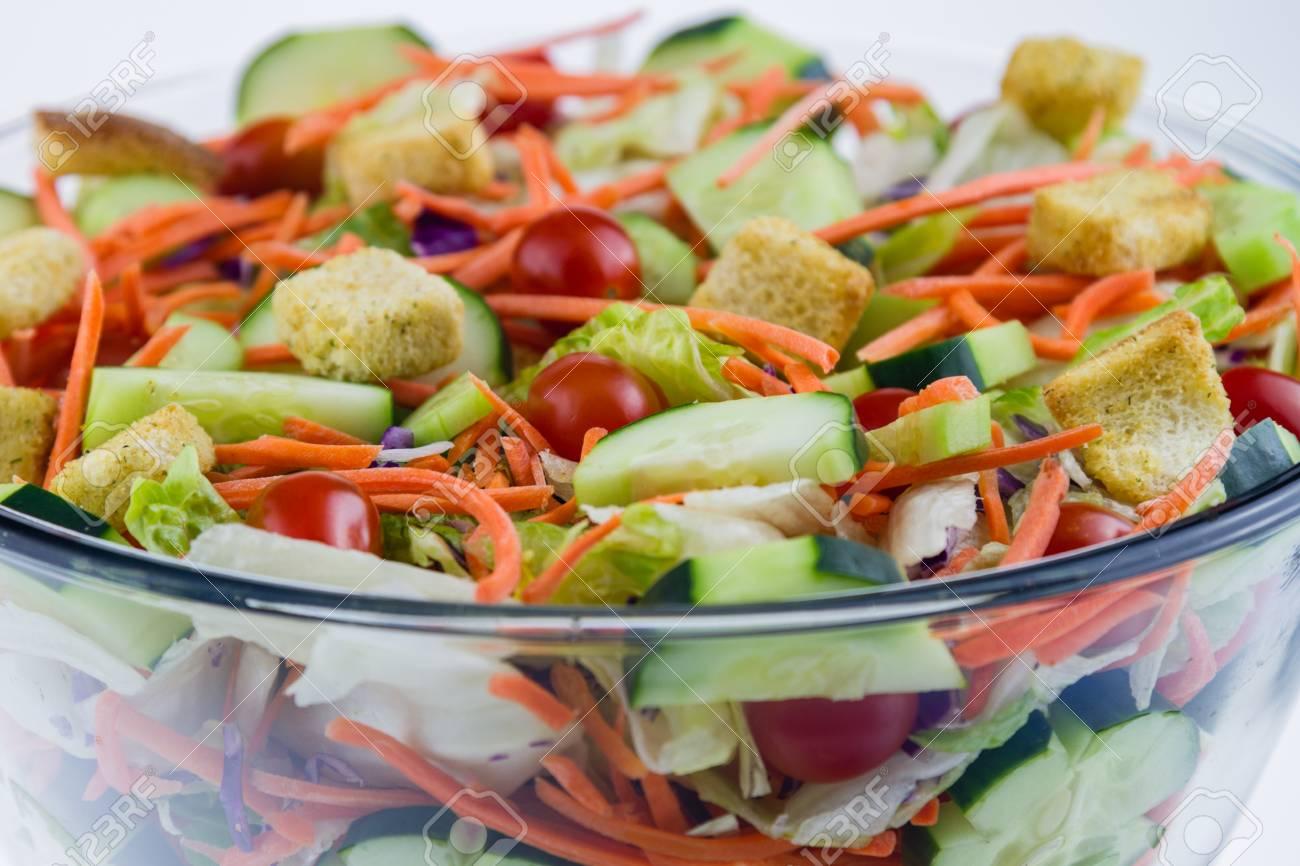 Fresh Tossed Garden Salad Set Against A White Background