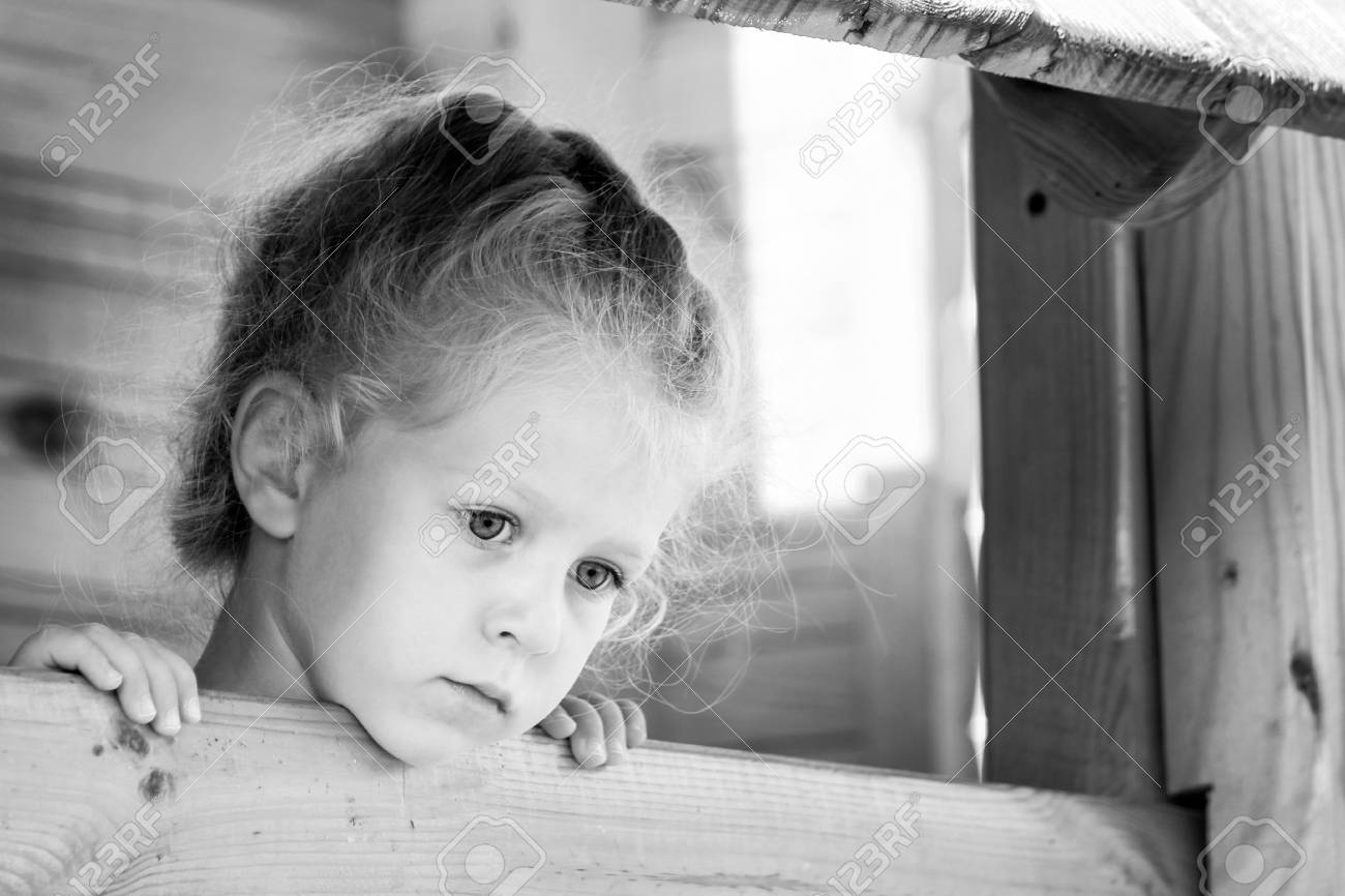 Little sad girl on the playground black and white series stock photo 85361080