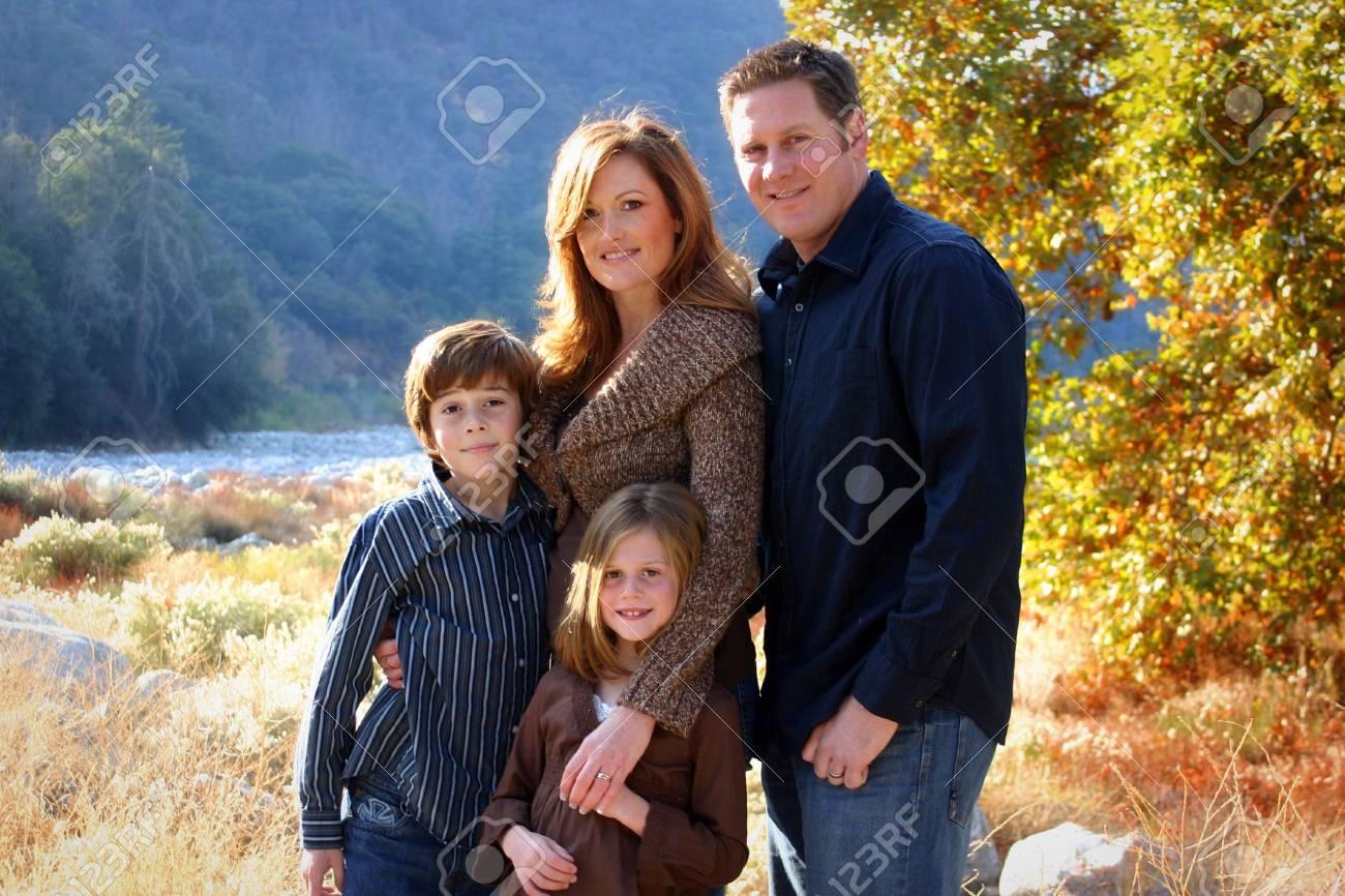 beautiful happy family next to creek Stock Photo - 7352102