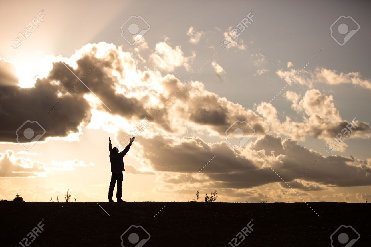 silhouette of a man with arms raised in worship Stock Photo - 16250338