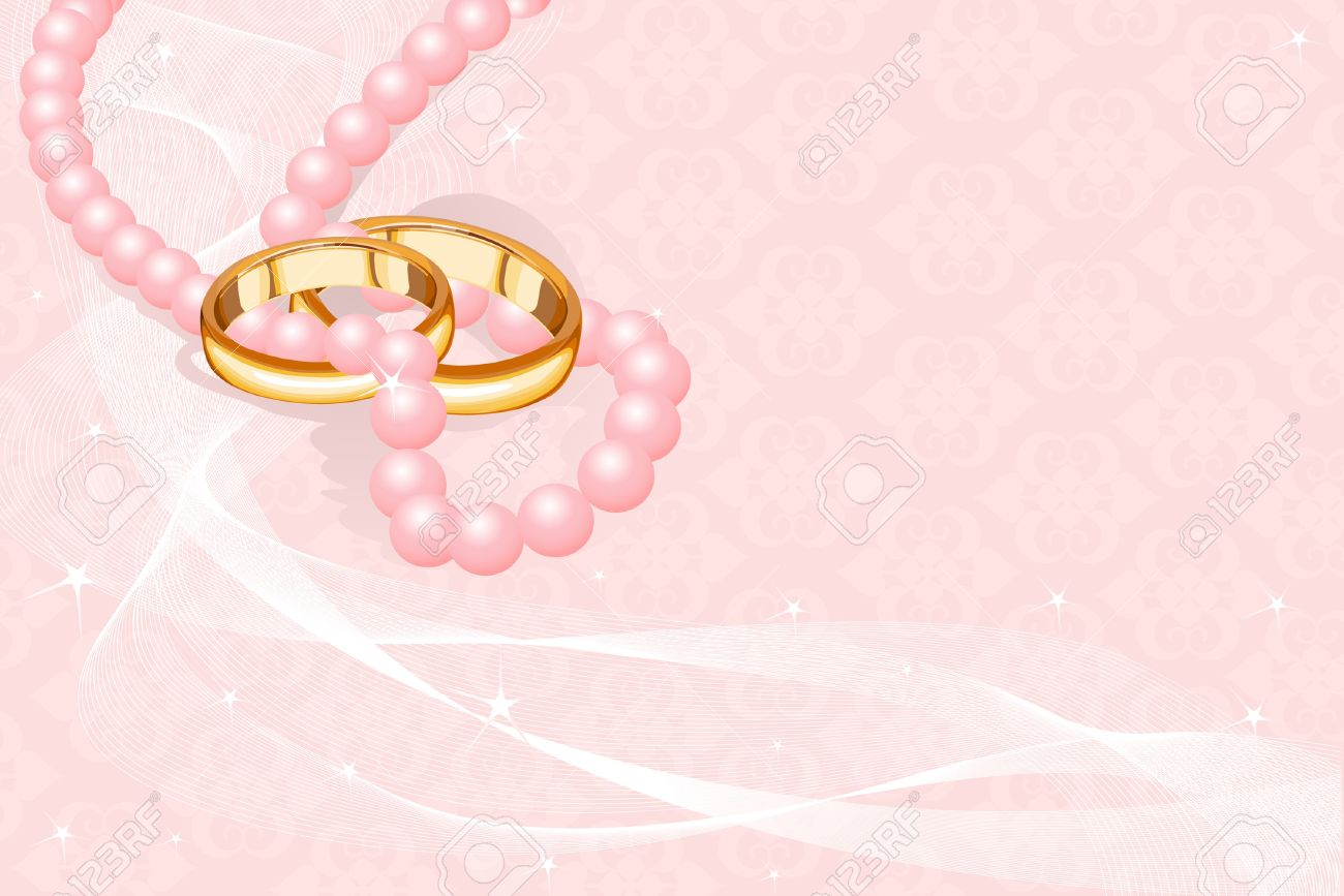 Wedding Rings On The Pink Background