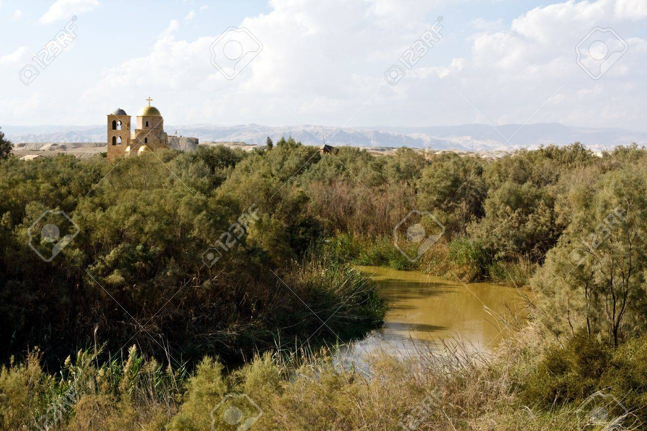 river jordan and church on the baptism site in bethany jordan