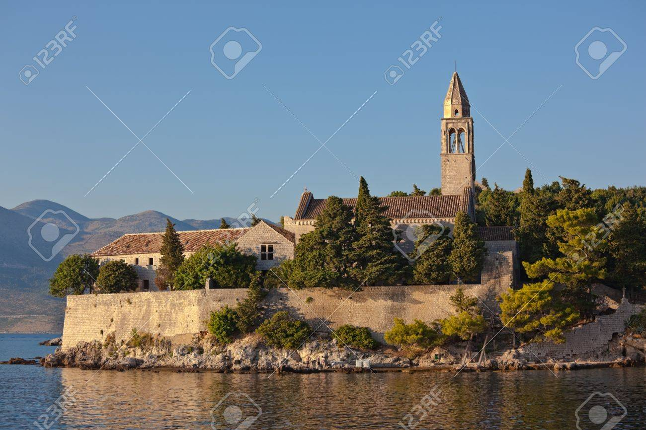 Mediterranean landscape at sunset. Island Lopud near Dubrovnik, Croatia. Old monastery with bell tower Stock Photo - 10476592
