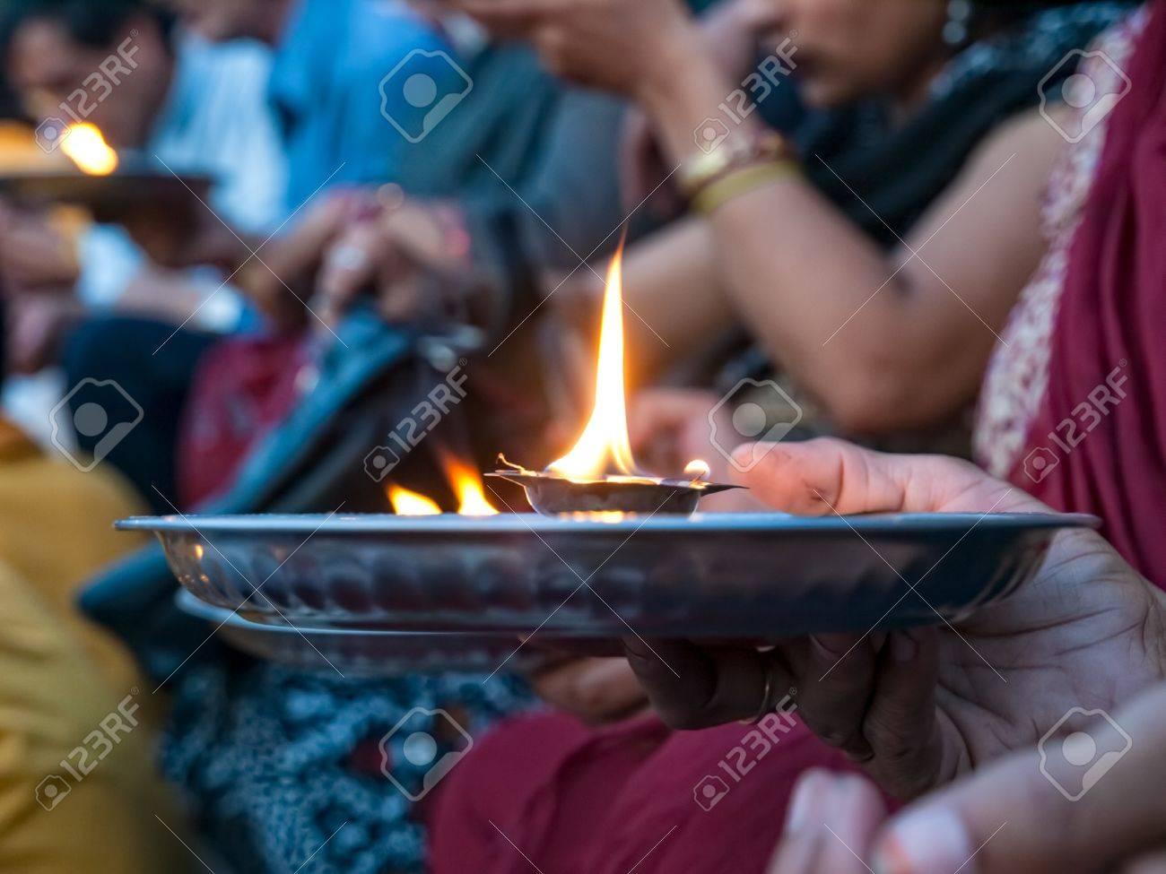 Hindu prayer ritual - detail with hand holding ceremonial fire, Rishikesh India. - 14821663
