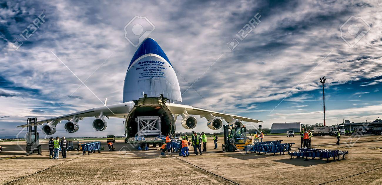 ZAGREB, CROATIA - NOVEMBER 10: Loading heavy weight cargo to the Antonov 225 Mriya airplane shoot as HDR on November 10, 2013 Zagreb, Croatia. It is the biggest airplane in the world. - 25220399