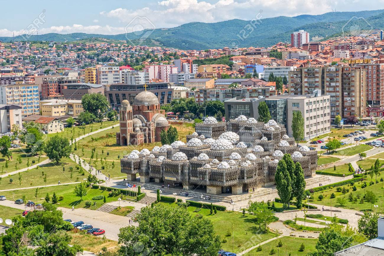 PRISTINA, KOSOVO - JULY 01, 2015: Aerial view of capital city with some old buildings like National Public Library and Christ the Saviour Cathedral. - 44425463