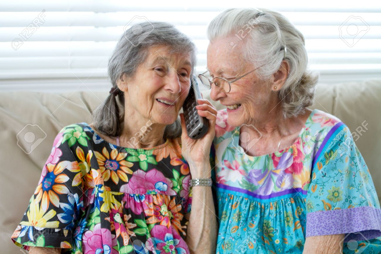 Two Elderly Ladies Talking On The Telephone Stock Photo - 12148759