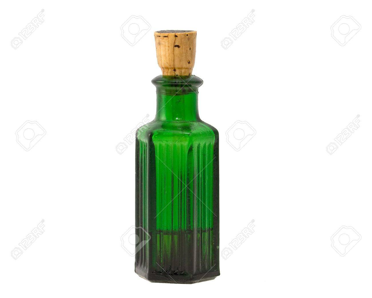 Old fashioned green chemical bottle. isolated on white Stock Photo - 8117710