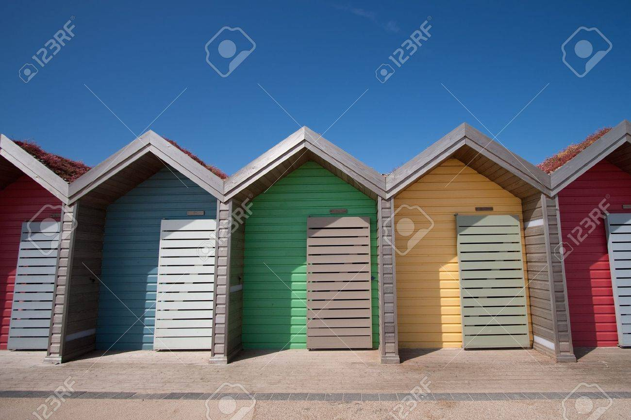 row of beach huts in blyth northumberland uk stock photo