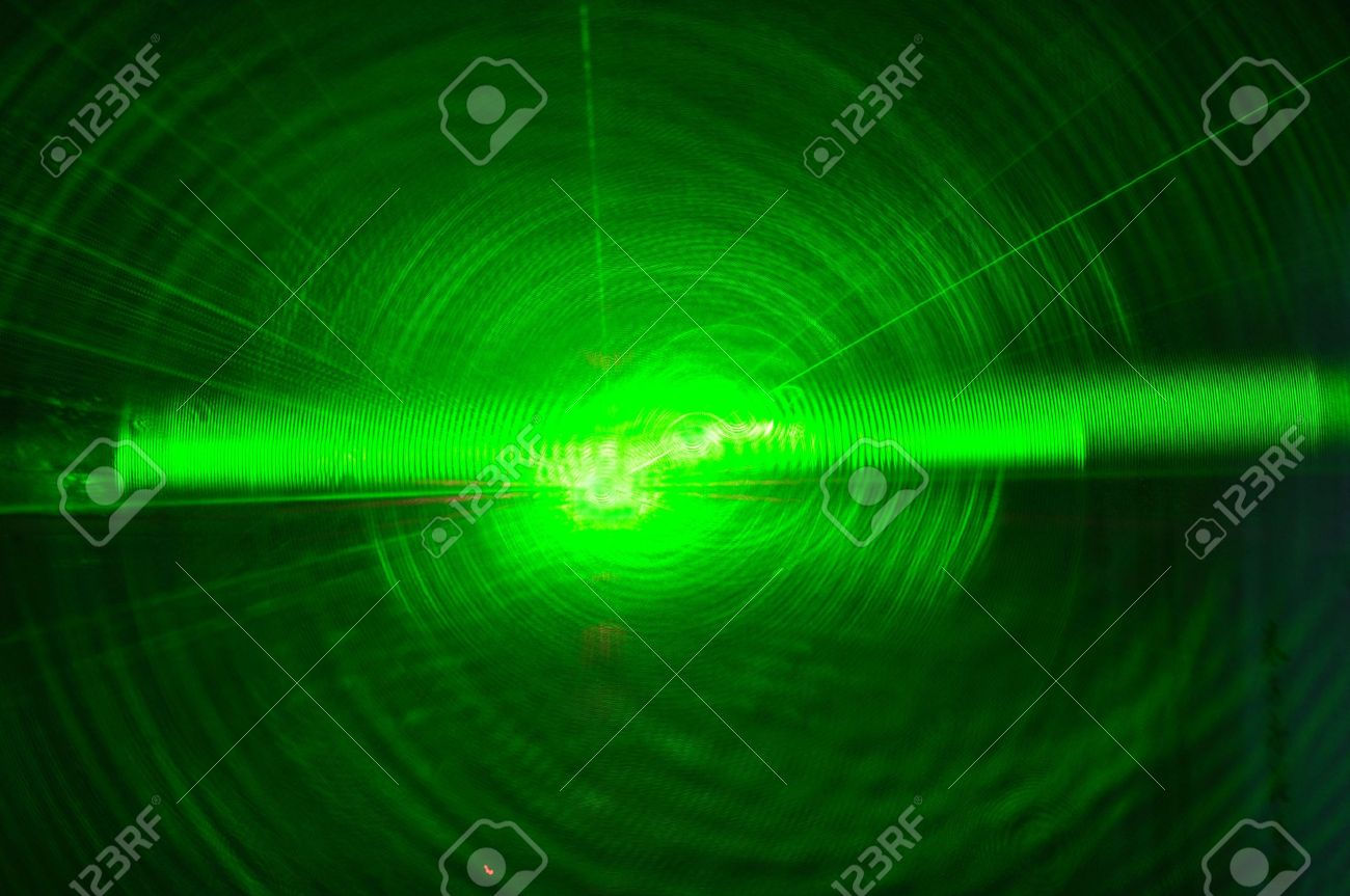 Bright green laser beam from darkness Stock Photo - 6660746